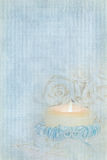 Candlelight Wedding. Bridal satin garter wrapped around a candle Royalty Free Stock Images