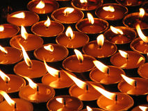 Candlelights. Glowing candlelights are used by Tibetans as gifts to gods and Buddhas Stock Photography