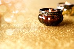 Candlelights on golden glittering background Royalty Free Stock Photo