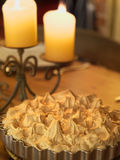 Candlelit meringue pie Stock Images