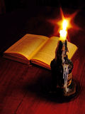 Candlelit reading Stock Images