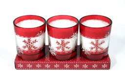 Candles 01. Three red christmas candles on a white background Royalty Free Stock Images