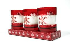 Candles 02. Three red christmas candles on a white background Royalty Free Stock Photos