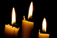 Candles. Three candles with black background royalty free stock image