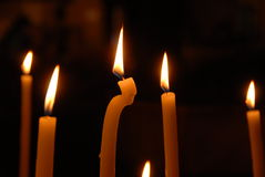 Candles. Melting candles in a church royalty free stock photography