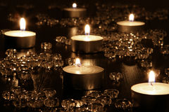 Candles. See view candles (tealights ) on dark wooden table with crystlas Royalty Free Stock Photo