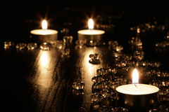 Candles. See view candles (tealights ) on dark wooden table with crystlas Stock Photos
