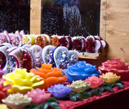 Candles. Decorative candles in the shape of multicolored roses and heart Stock Photography