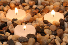 Candles. Three candles burning between stones in a spa Stock Photos