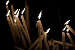 Candles. Lights in a church Stock Images