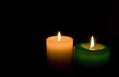 Candles. Two candles on the black background Royalty Free Stock Photo