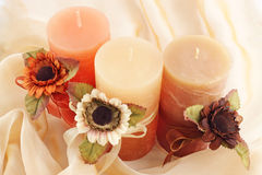 The candles. Three large  candle with the flowers  on the cloth Royalty Free Stock Images