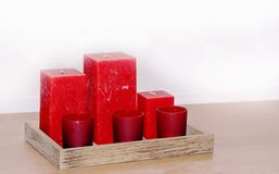 Candles. Set of red candles on wooden tray royalty free stock images