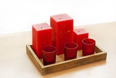 Candles. Set of red candles on wooden tray royalty free stock photos