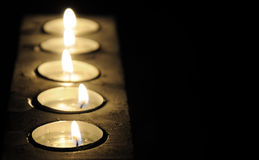 Candles. Five candles on black background Royalty Free Stock Photo