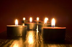 Candles. Group of small candles on red background Stock Image