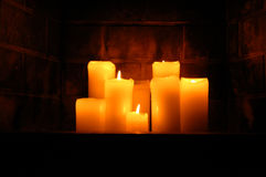 Candles. Eight candles arranged in a fireplace Royalty Free Stock Photo