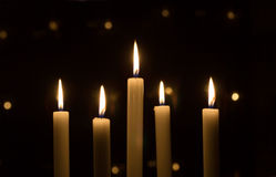Candles. White christmas candles on dark black background Royalty Free Stock Photo