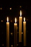 Candles. White christmas candles on dark black background Royalty Free Stock Photography