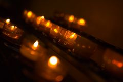 Candles. A row of candles in church Royalty Free Stock Photo