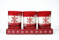 Candles. Three red christmas candles on a white background Stock Images