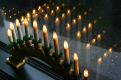 Candles. Artificial candles on a window sill of restaurant Royalty Free Stock Photo