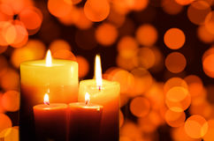 Candles. With blurred lights in the background Stock Photo