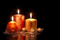 Candles. And Christmas toys on a black background Royalty Free Stock Photo