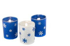 Candles. Holiday candles with snowflakes and glitter Stock Photo
