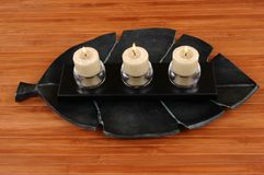 Candles. Aromatic candles in glass candle holders on bamboo mat Royalty Free Stock Image