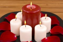 Candles. Red rose petals and candles in a spa Royalty Free Stock Photography