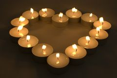 Candles. Group of burning candles placed in form of heart Royalty Free Stock Photos