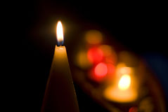 Candles. Candle with colorful background of other candles lights Royalty Free Stock Photos
