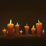 Candles. Several burning candles on the dark background Stock Images