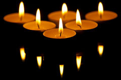 Candles. Six candles with reflection on black glass Royalty Free Stock Images