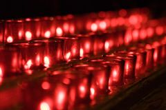 Candles. Red candles lined up in a row stock photography