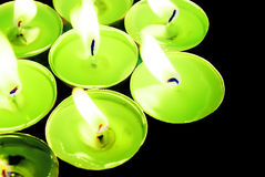 Candles. Green tea candles in own light Royalty Free Stock Photo