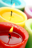Candles. Burning colored wax candles (Closeup royalty free stock image