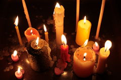 Candles. Different candles burning in the darkness Stock Photo