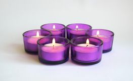 Candles. Some purple candles with flame Royalty Free Stock Image