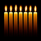 Candles. Burning candles on black background royalty free illustration