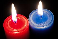 Candles. Red and blue burning candles Stock Image