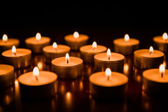 Candles. Some small and burning candles Royalty Free Stock Photography