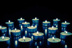 Candles. Some small and burning candles Royalty Free Stock Photos