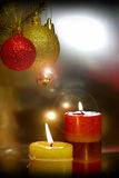 Candles. With christmas balls in atmospheric light Stock Photography