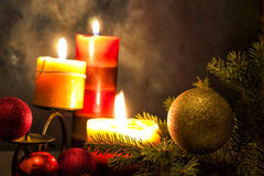 Candles. With christmas balls in atmospheric light Royalty Free Stock Images