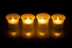 Candles. Four small scented candles in the dark Stock Images