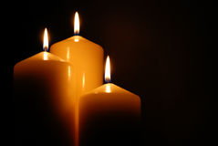 Candles. Warm candles - spiritual, seasonal, romantic or religious image Stock Images