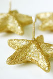 Candles. Big gold stars, christmas candles Royalty Free Stock Images