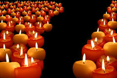 Candles. Red and yellow candles on black background Royalty Free Stock Photos
